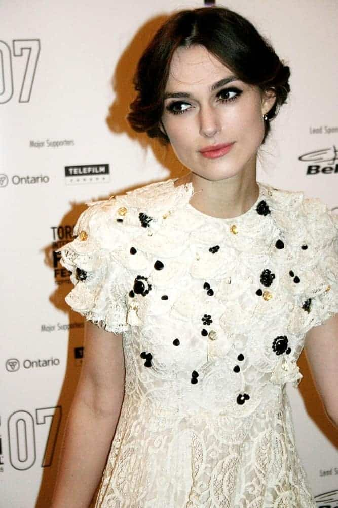 Keira Knightley was at the Premiere of Silk at the 32nd Annual Toronto International Film Festival, Elgin Theatre VISA Screening Room, Toronto on September 11, 2007. She came in a detailed white dress that she paired with her messy low bun hairstyle with a center part.