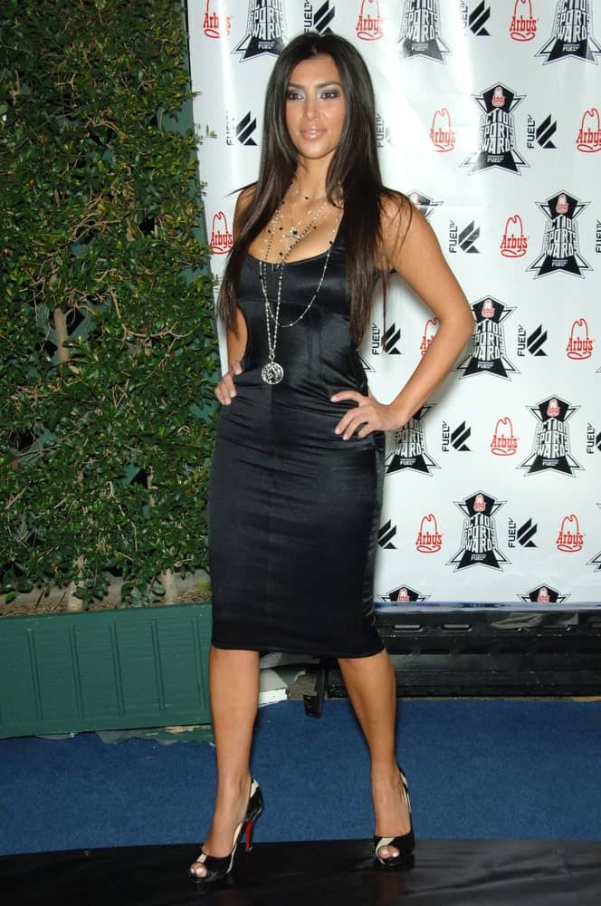 Kim Kardashian in a form-fitting gown that's a perfect match on her long layered hair at the Inaugural Arby's Action Sports Awards in Burbank, CA held on November 30, 2006.