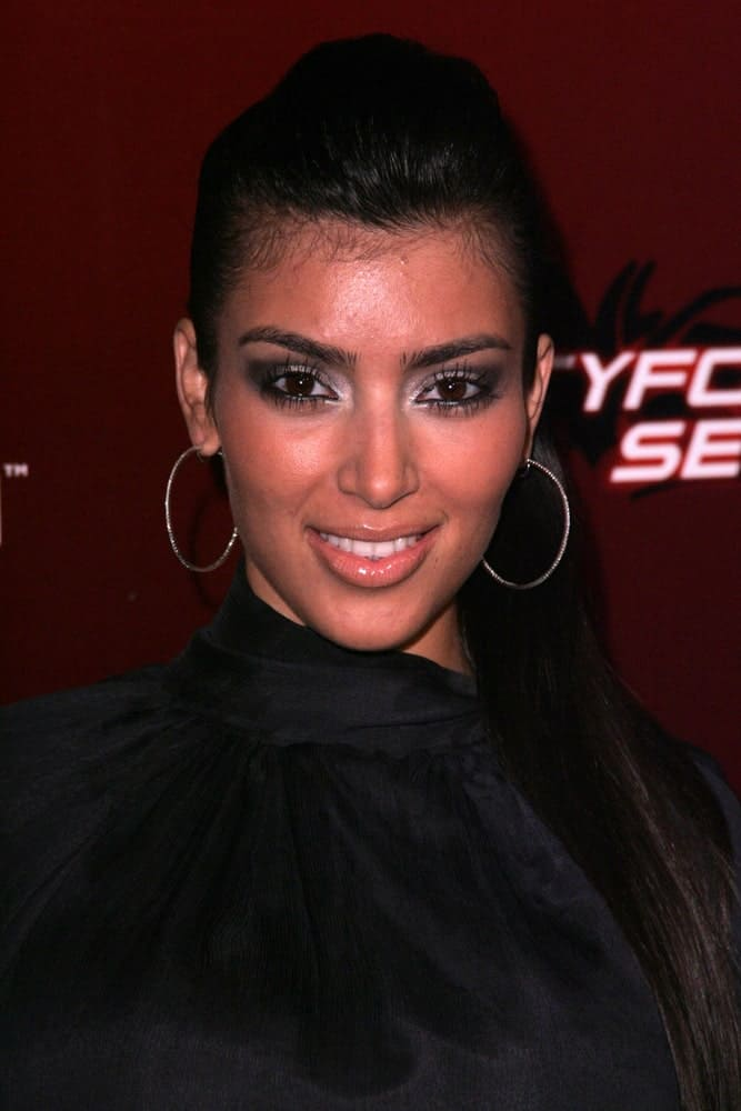 Kim Kardashian wore a black turtle neck dress along with a high ponytail for the party launching of the new MTV series