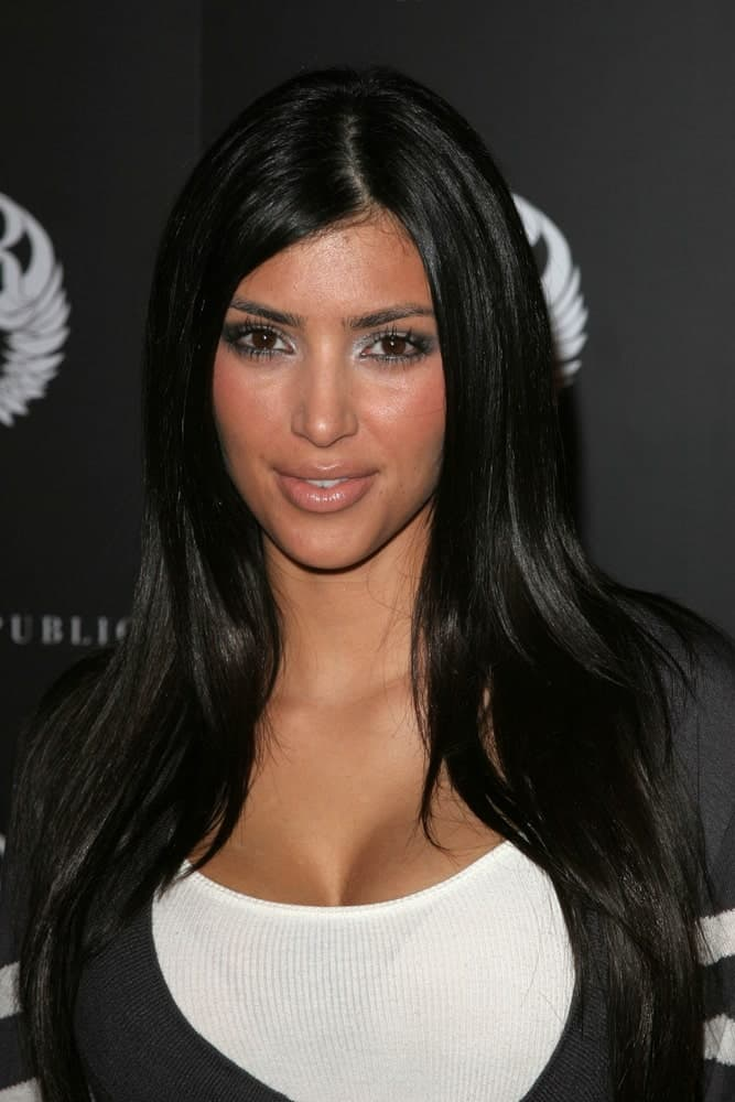 Kim Kardashian kept it casual with her straight layered tresses and a sweater at the Rock And Republic Spring Fashion Show held on October 18, 2006.