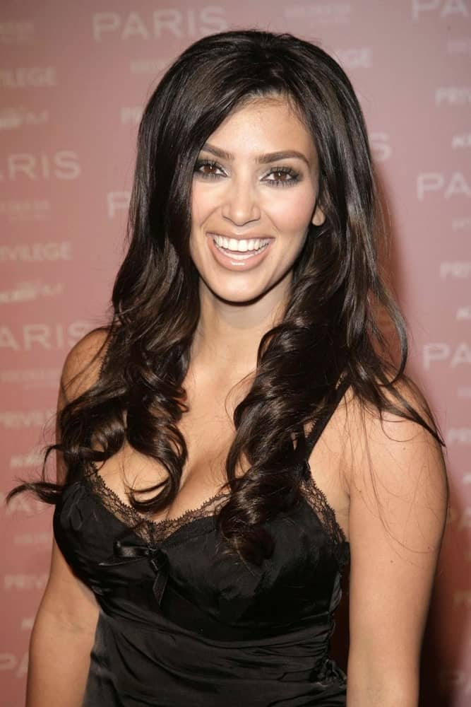Kim Kardashian flashed a big smile with her sleek twisted waves during the Paris Hilton PARIS CD Launch Party at Privilege night club, Los Angeles, CA on August 18, 2006.