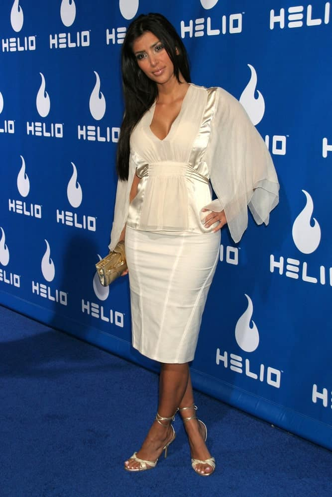 Kim Kardashian contrasts her loose jet black hair with a white formal gown during the Helio Drift Launch Party at 400 South La Brea on November 13, 2006.