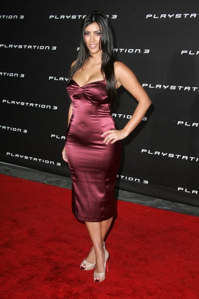 Kim Kardashian stands out in a red dress paired with a straight layered hairstyle as she attends the Playstation 3 Launch Party on October 8, 2006.