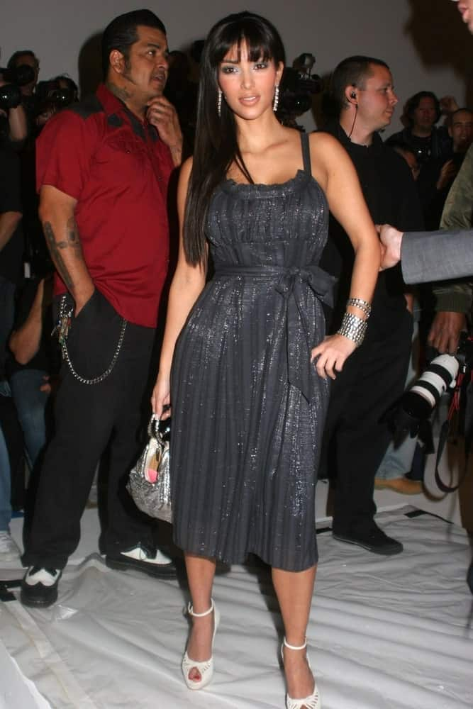 On March 20, 2007, Kim Kardashian wore a cute gray dress that perfectly goes with her long straight hair at day three of the 2007 Mercedes-Benz Fashion Week Fall Collection.