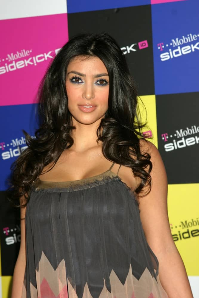 Kim Kardashian with stylish black curls cascading down her shoulders during the T-Mobile Sidekick Party last April 14, 2007 in Los Angeles, CA.