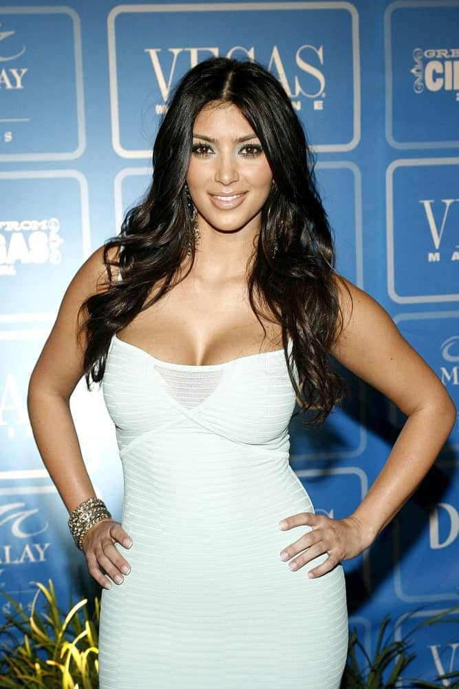 During the Vegas Magazine 4th Anniversary & Closing Night Party at the 2007 CineVegas Film Festival on June 16th, Kim Kardashian exhibited her long wavy hair paired with a white Herve Leger dress.