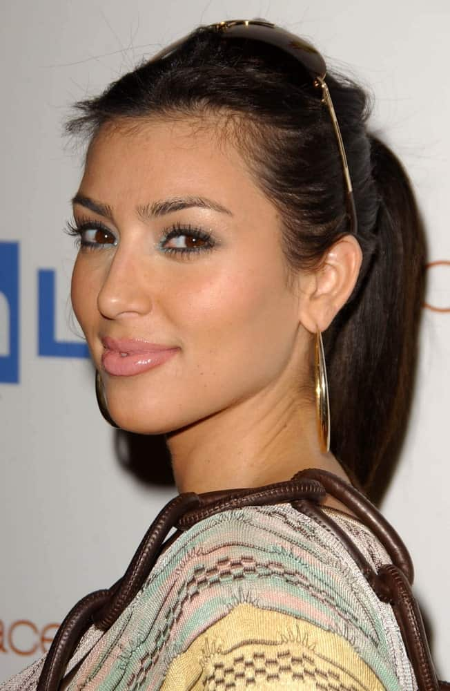 On June 21, 2007, Kim Kardashian went for a high ponytail incorporated with shades as she attends the OmniPeace Benefit To Stop Extreme Poverty in Sub-Saharan Africa.