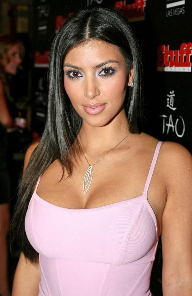 Kim Kardashian paired her pink top with a straight layered hairstyle during the STUFF Magazine Music Issue Party at Tao, Las Vegas, NV on July 28, 2007.