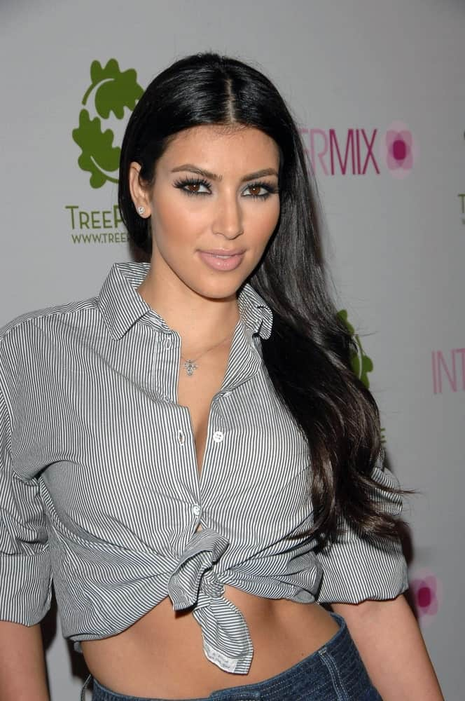 Kim Kardashian arrived at INTERMIX Debut, Intermix Store on September 25, 2007, with her long loose waves that she gathered on one side.