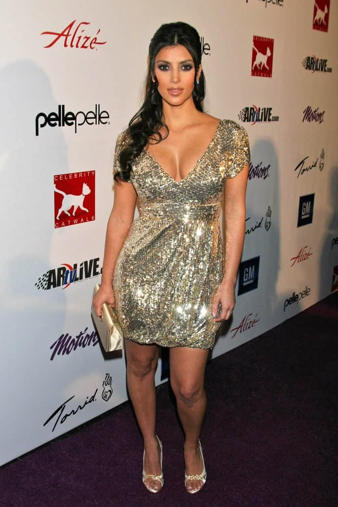 Kim Kardashian arranged her long curly locks into a glam half updo at Celebrity Catwalk for Charity held on August 16, 2007 at The Highlands Nightclub, Hollywood, CA.