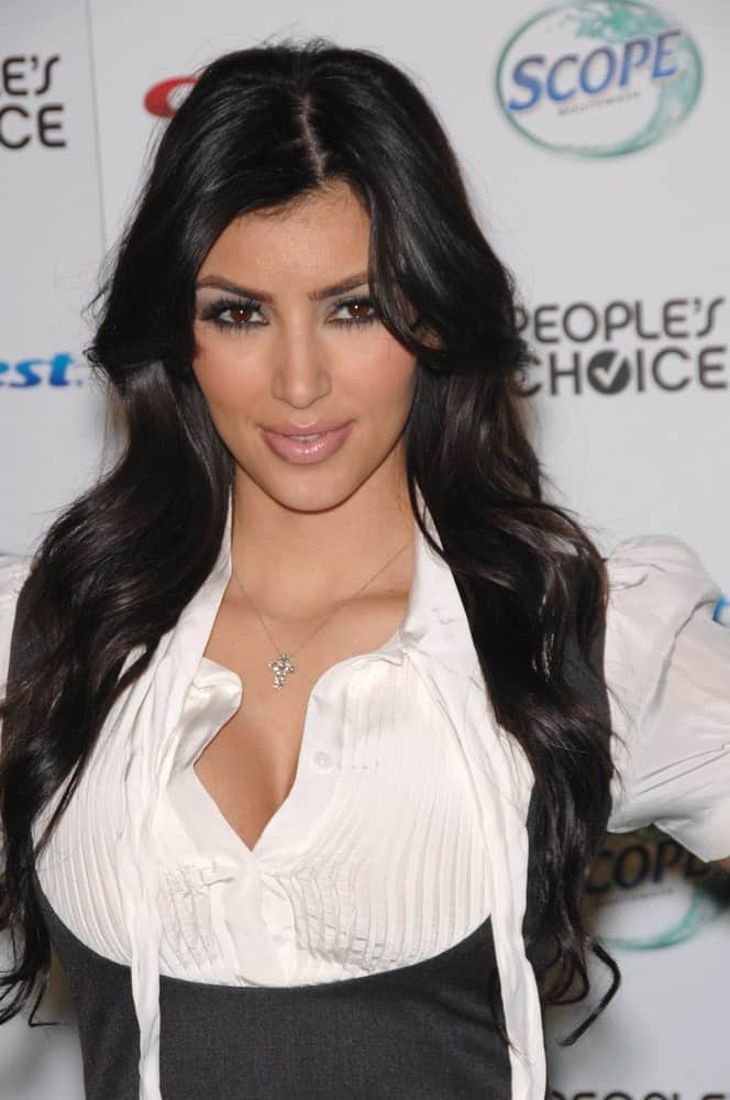 Kim Kardashian appeared at nominations announcement party for the People's Choice Awards at Area Nightclub, West Hollywood on November 9, 2007, sporting her long loose waves with a side parting.