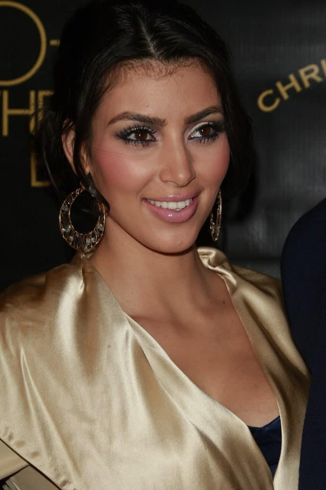 Kim Kardashian with her black locks arranged into a messy upstyle during the Designer Christian Audigier`s 50th Birthday Bash at the Peterson Automotive Museum on May 23, 2008.