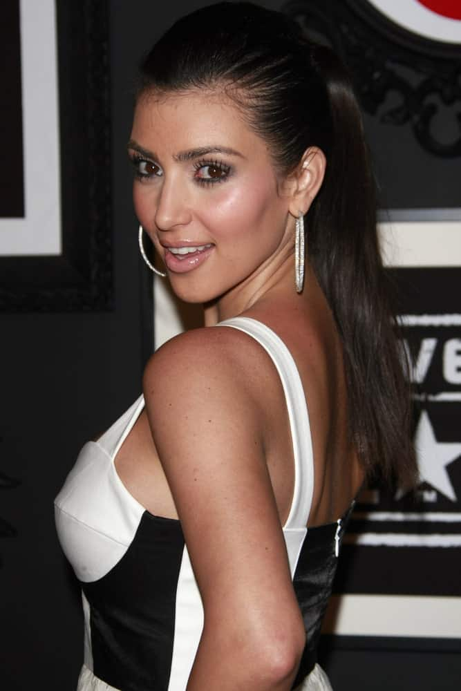 Kim Kardashian in a high ponytail during the Target & Converse Party at the Lot on June 1, 2008, in Los Angeles, California. Hoop earrings and a black and white dress completed the sleek look.