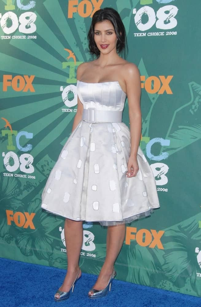 Kim Kardashian looking all charming and gorgeous in a Bradley Bayou dress paired with a messy loose upstyle during the 2008 Teen Choice Awards held at Gibson Amphitheatre on August 3, 2008.
