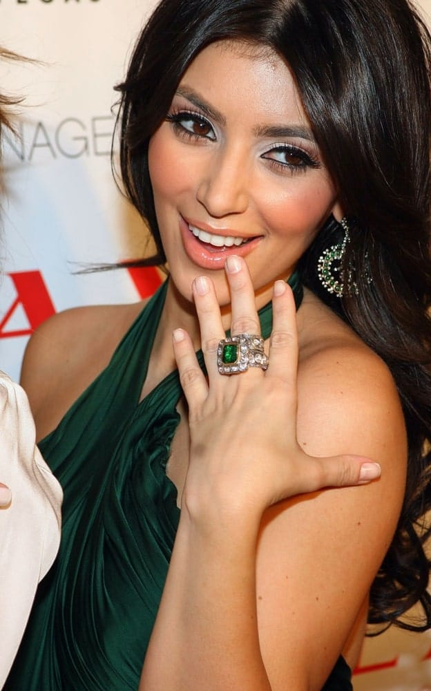 Kim Kardashian with her long loose curls during her 28th Birthday Party at LAX on October 24, 2008. She finished the look with a matching green halter dress and emerald ring.