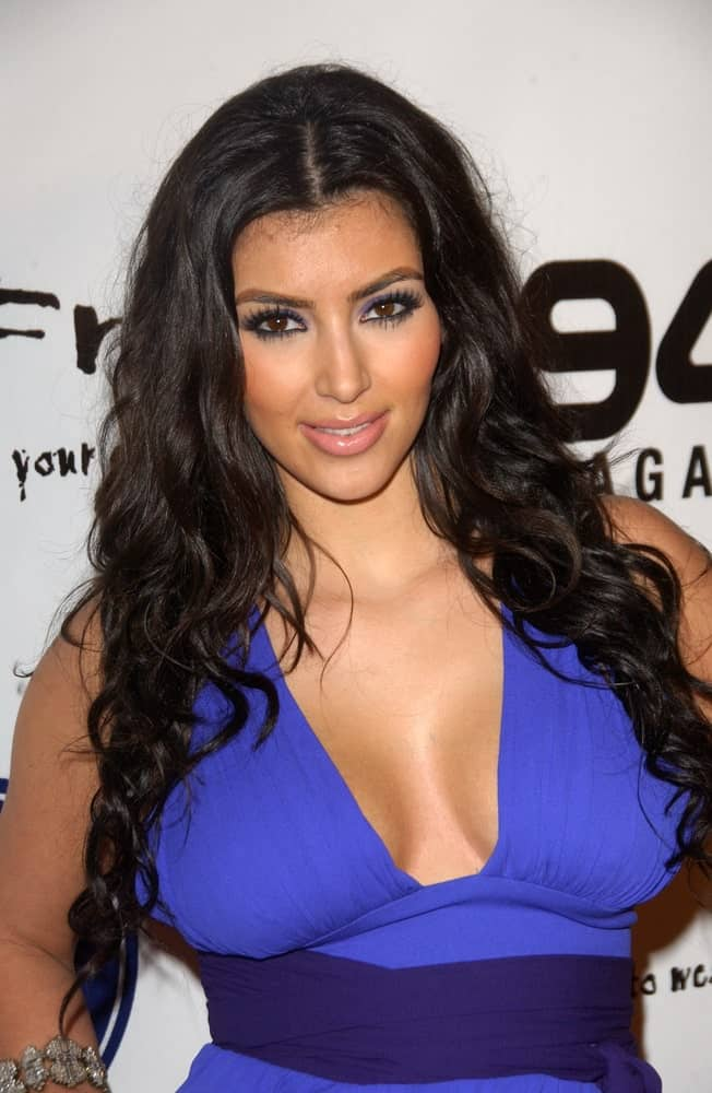 Kim Kardashian paired her blue dress with a long curly hairstyle at the Debut of 2 B Free Spring 2008 Collection held on October 14, 2007.