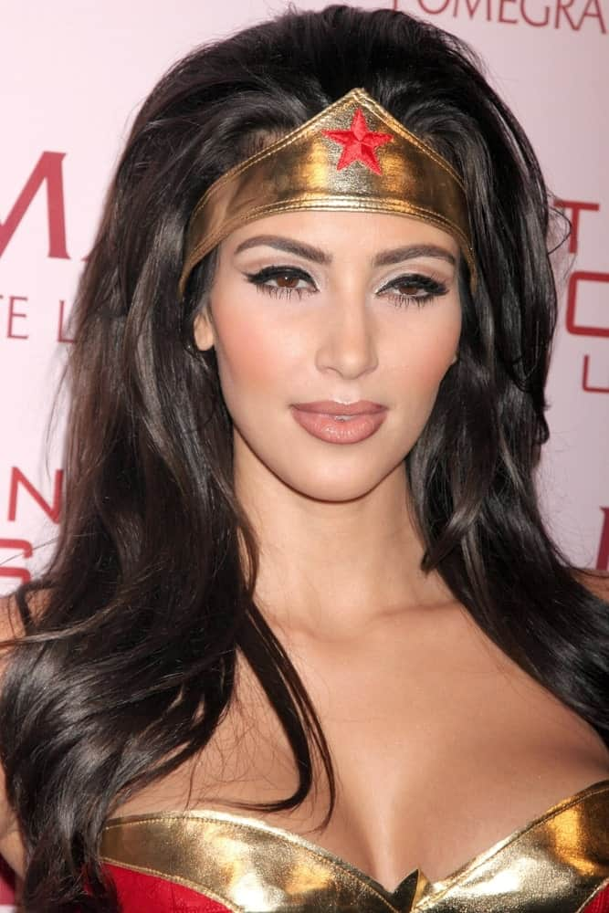 Kim Kardashian in a wonder woman costume complemented with her loose thick hair at PAMA's Halloween Masquerade at Stone Rose, Los Angeles, CA on October 30, 2008.
