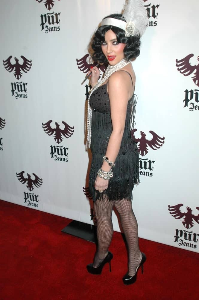 Kim Kardashian flaunting her short curly hair at the Pur Jeans Halloween Bash at STK, Los Angeles, CA on October 31, 2008.