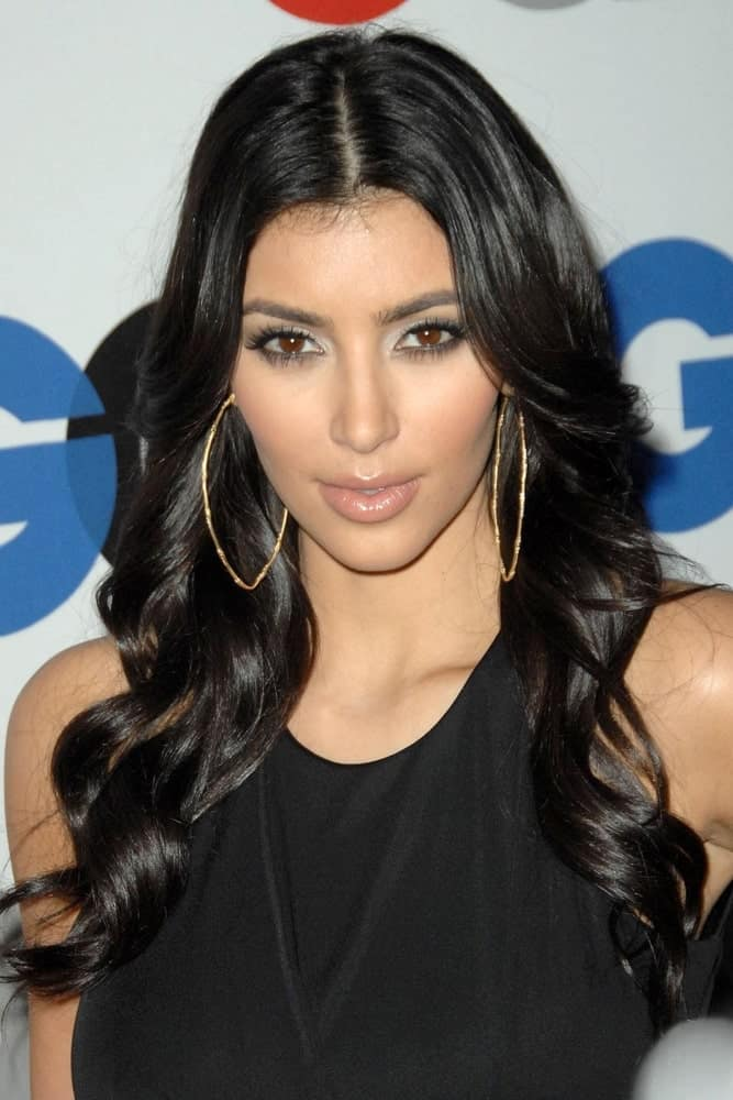 Kim Kardashian with her center-parted waves paired with big hoop earrings at The 13th Annual GQ 'MEN OF THE YEAR' Party, Chateau Marmont Hotel, Los Angeles, CA on November 18, 2008.