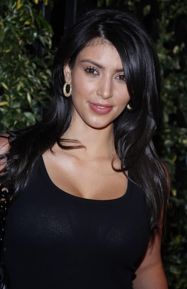 Kim Kardashian attended the opening of Beso Restaurant held at the Beso in Hollywood, California last June 3, 2008, with her long jet black hair styled with subtle waves.