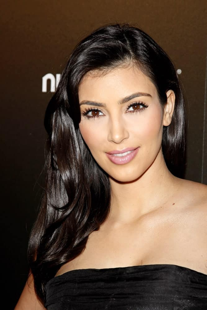 Kim Kardashian with her shiny black locks in a side-part at the party for TV Guide Magazine's Sexiest Stars held at the Sunset Tower Hotel on March 24, 2009.