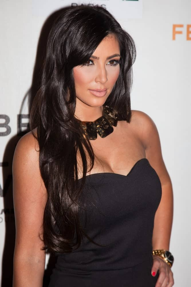 Kim Kardashian complemented her black dress with a loose layered hairstyle during the 'Wonderful World' premiere at the Tribeca Film Festival on April 27, 2009