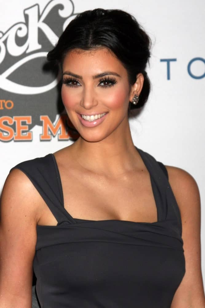 Kim Kardashian appeared at the Rock to Erase MS Gala at the Century Plaza Hotel on May 8, 2009, wearing a simple gray gown paired with a center-parted bun.