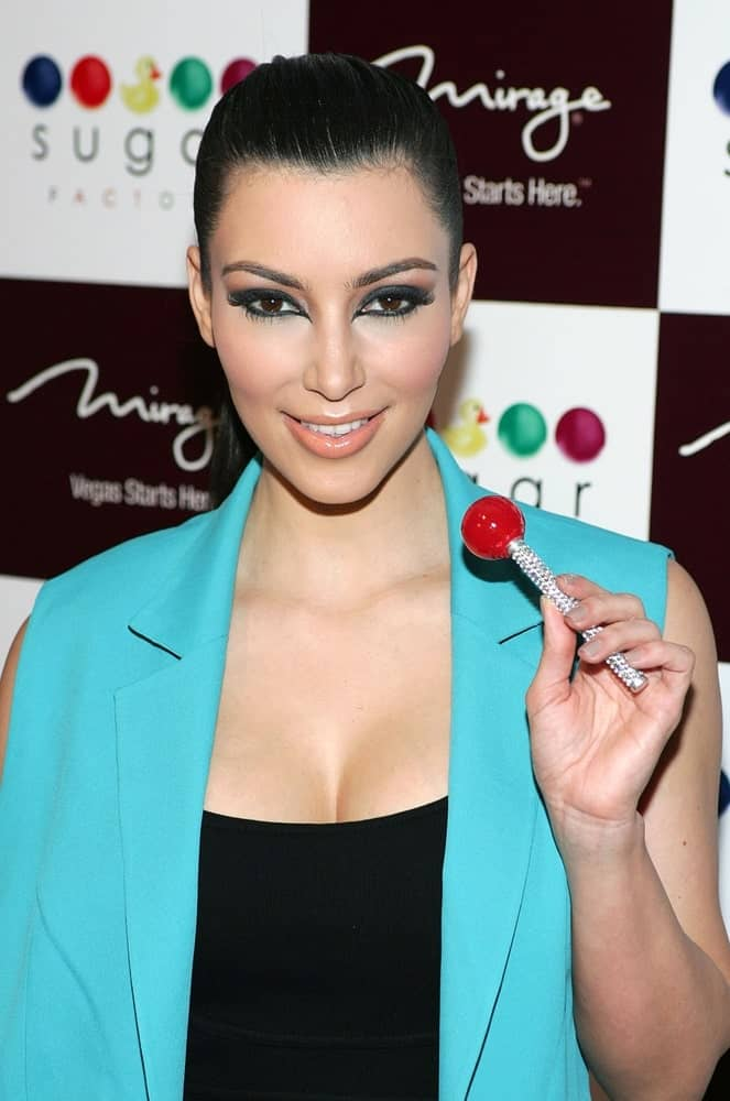 Kim Kardashian sported a slick high ponytail that complements her smoky eyes during an in-store appearance for SUGAR FACTORY Couture Candy Store Grand Opening at The Mirage last June 26, 2009.