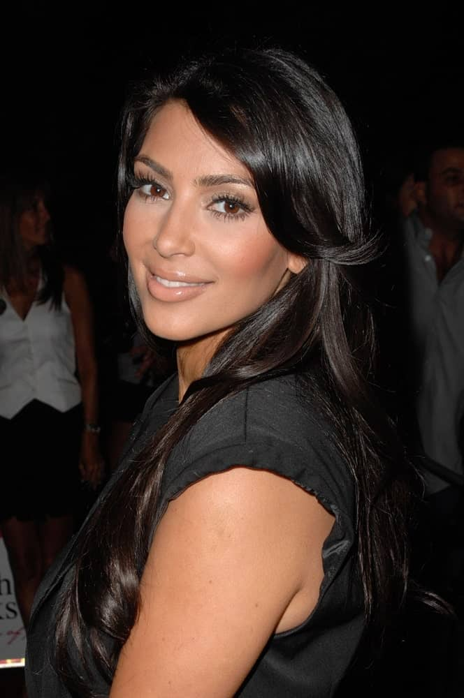 Kim Kardashian was seen at the Ocean Pacific Op New Fall Advertising Campaign Launch Party on July 7, 2009, rocking her loose jet black hair with long wavy side bangs.