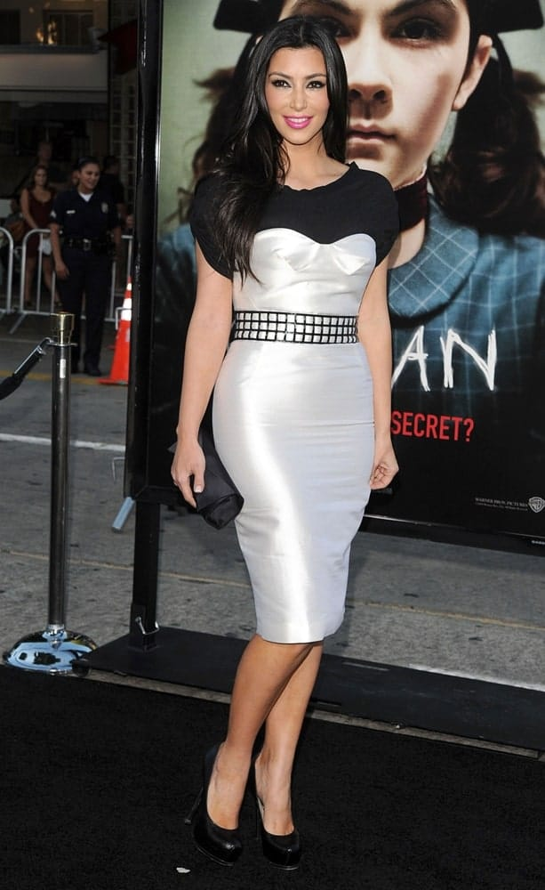 On July 21, 2009, Kim Kardashian attended the ORPHAN Premiere at Mann's Village Theatre in Westwood, Los Angeles wearing a Proenza Schouler dress and a YSL belt paired with her jet black loose hair.