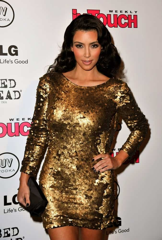 Kim Kardashian shines in a gold sequined gown complemented with her voluminous curls at IN TOUCH WEEKLY'S ICONS + IDOLS CELEBRATION MTV VMA After Party held on September 13, 2009.