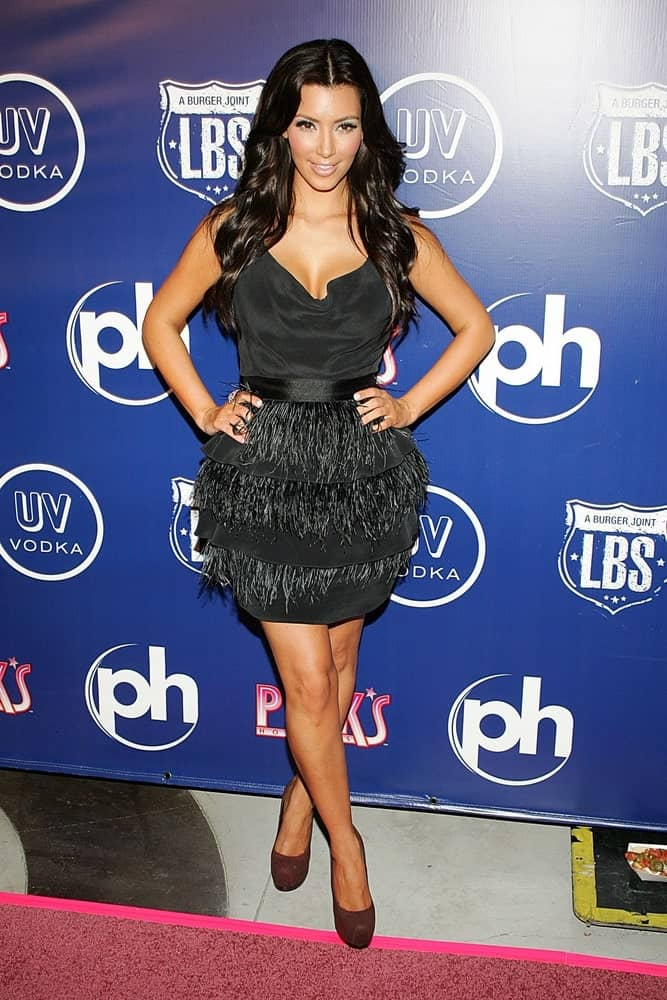 On September 18, 2009, Kim Kardashian matched her short black dress with her shiny raven waves during Pink's Hot Dogs Las Vegas Grand Opening at Planet Hollywood Resort and Casino, Las Vegas, NV.