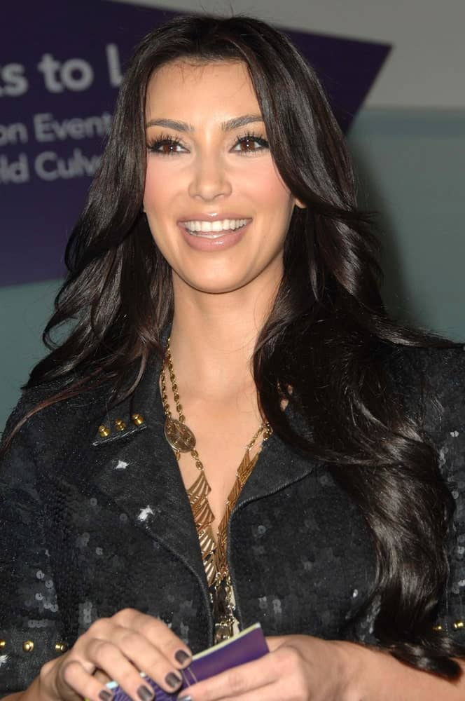 Kim Kardashian exhibited her long layered waves with middle parting as she made an appearance by the OK! Magazine's Beauty Editor at Westfield Culver City on November 7, 2009.