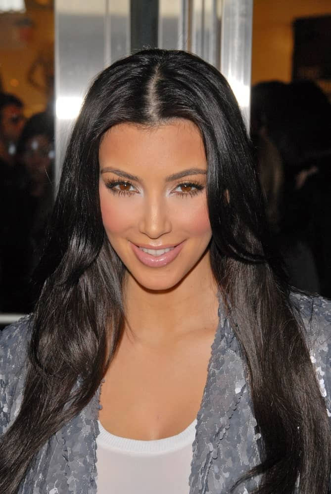 Kim Kardashian at the Launch Event for FusionBeauty's Infatuation Lip Gloss on October 15, 2009 showing off her simple loose waves with a middle parting.