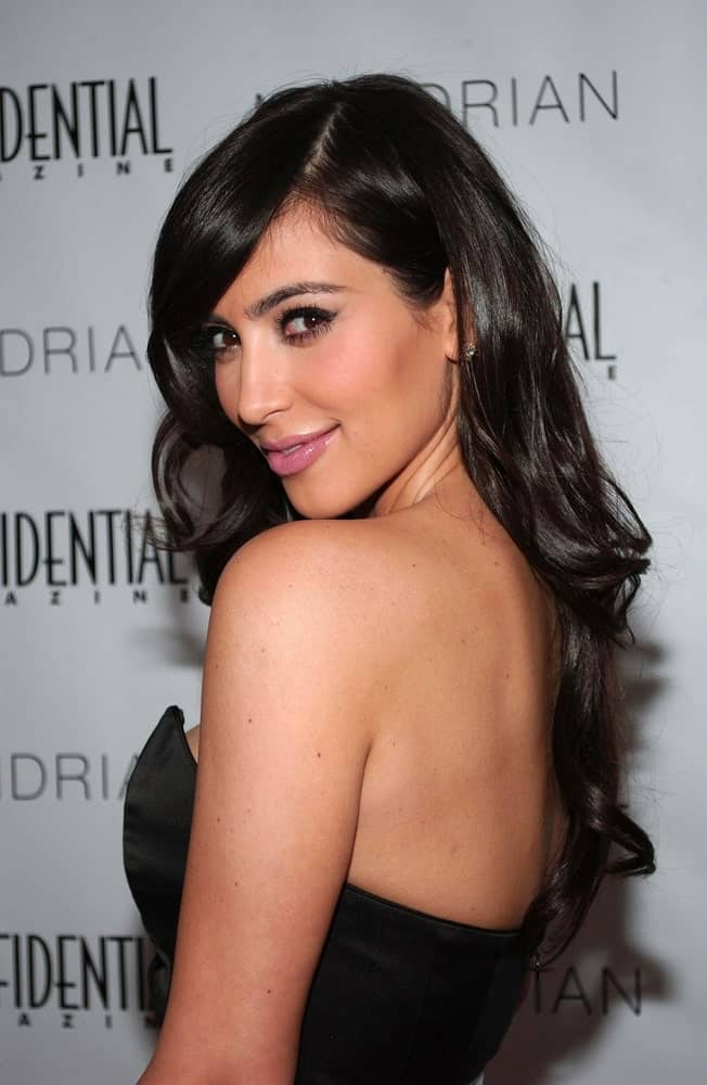 Kim Kardashian incorporates her long wavy locks with side-swept bangs during the Los Angeles CONFIDENTIAL Magazine's Annual Golden Globes Party held on January 10, 2009.