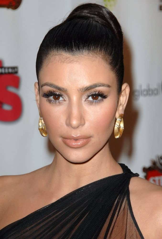 On February 8, 2009, Kim Kardashian was seen at Russell Simmons Salute to Grammy Award Nominees' celebration After Party with her jet black hair arranged into a slicked high bun.
