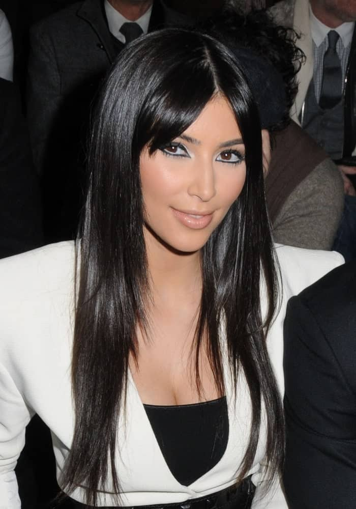 Kim Kardashian was spotted at the Y-3 Fall 2009 Collection Fashion Show on February 15, 2009, wearing a contrasting black and white outfit along with her long layered locks incorporated with curtain bangs.