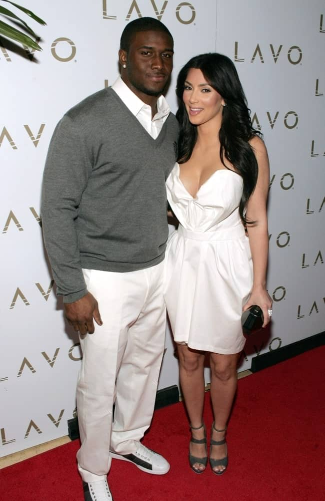 Kim Kardashian with Reggie Bush in attendance for Queen of Hearts Ball at LAVO Restaurant and Nightclub on February 13, 2010. The socialite sported a long wavy hairstyle with a middle parting.