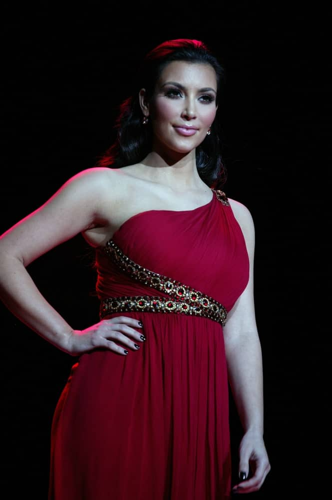 Kim Kardashian walked the runway in a red Marchesa dress along with her classic waves at the Heart Truth's Red Dress Collection for Fall 2010 during Mercedes-Benz Fashion Week on February 11, 2010.