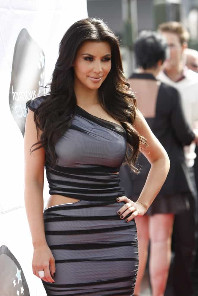 Kim Kardashian struck a pose with her long wavy hair at the Launch of Kim Kardashian Vanilla Cupcake Mix Famous Cupcakes held on February 19, 2010.