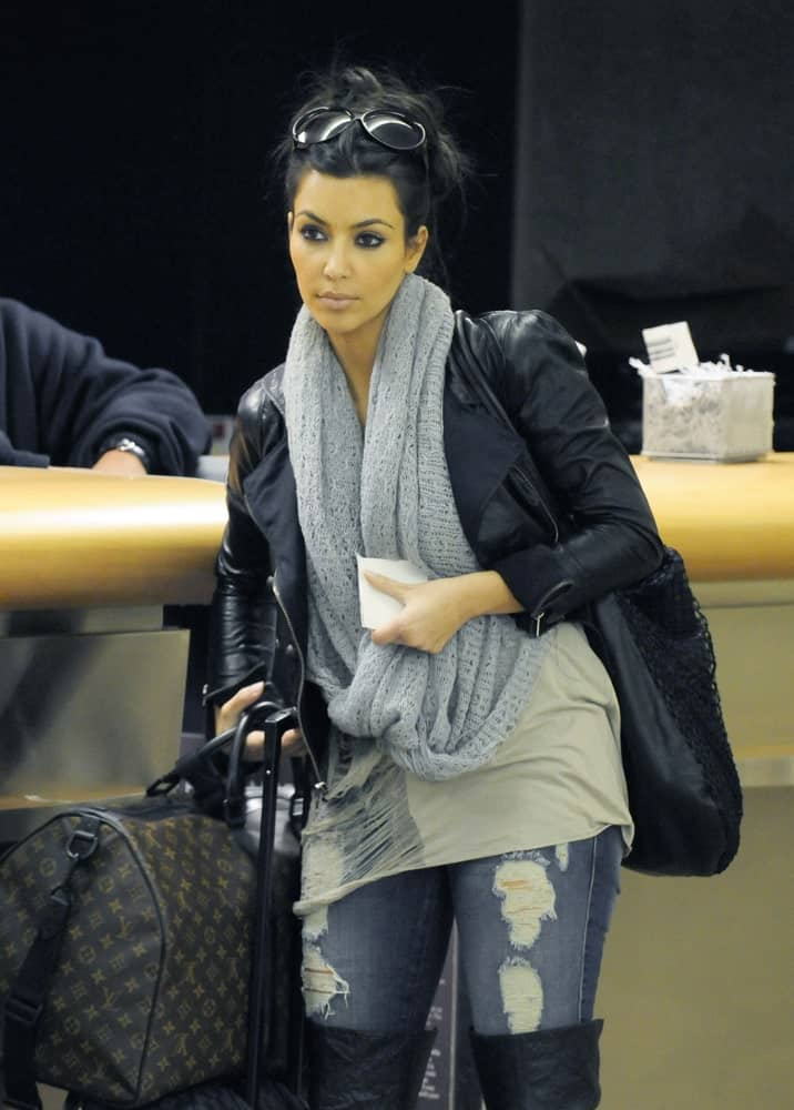 Model and socialite Kim Kardashian was spotted with her luggage at LAX on February 21, 2010. She's wearing a casual outfit along with a messy upstyle that's incorporated with black shades.