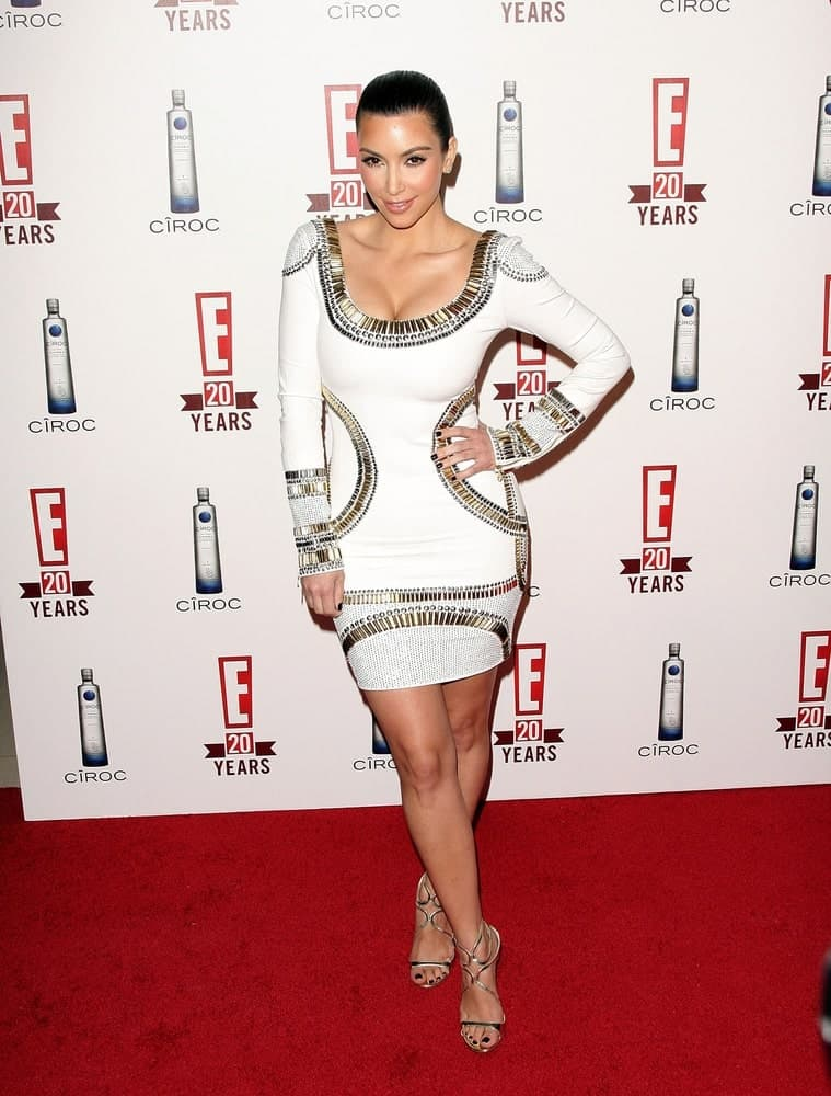 Kim Kardashian in a white bodycon dress along with a neat updo at the E! Television 20th Anniversary Party held on May 24, 2010 at The London West Hollywood Hotel, Los Angeles, CA.