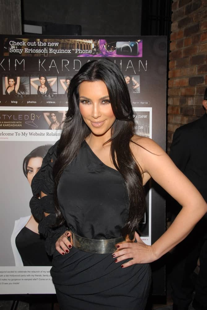 Kim Kardashian was seen with her long layered raven hair at a celebration for the re-launch of KimKardashian.com held on June 25, 2010, at the Tea Room, Hollywood, CA.
