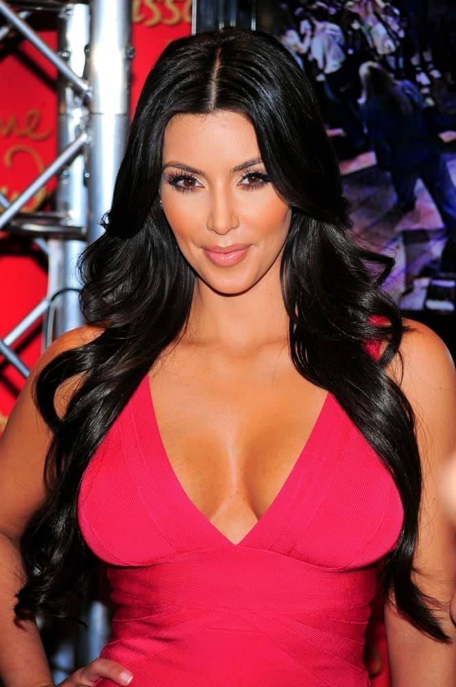 Kim Kardashian in attendance for Kim Kardashian Wax Figure Unveiling at Madame Tussauds, New York, New York held on July 1, 2010. She wore a sexy deep V neck dress that's complemented with a long wavy hairstyle.