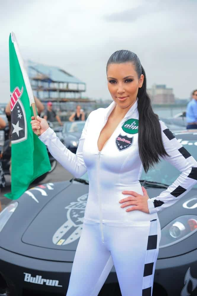 Kim Kardashian at a public appearance for The AMP Energy Bullrun Cross-Country Car Rally in Pier 54, New York held on July 10, 2010. She sported a high ponytail paired with a white race suit.