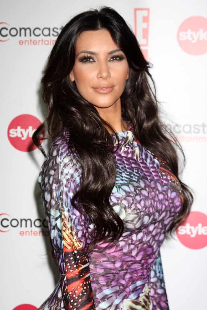 Reality star Kim Kardashian wore a colorful printed dress along with her jet black center-parted waves at the Comcast Entertainment Group Summer 2010 TCA Cocktail Party last August 6, 2010.