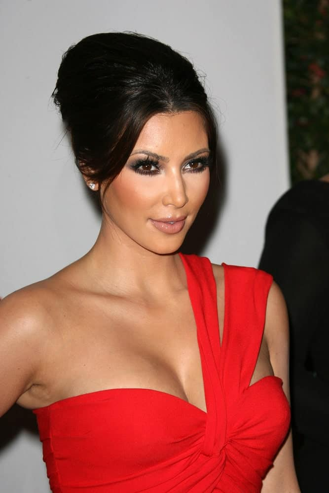 Kim Kardashian paired her gorgeous red dress with a sleek beehive updo during the LACMA presents