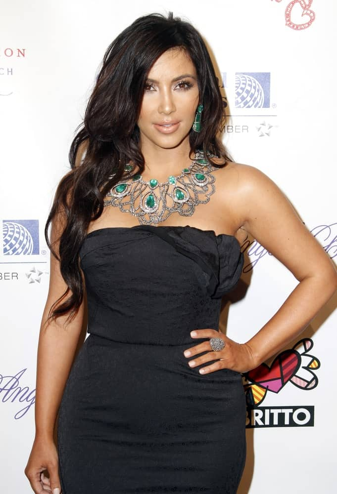 Kim Kardashian with her side-parted waves as she attends the Angel Ball 2010 hosted by Gabrielle's Angel Foundation for Cancer Research at Cipriani's on October 21, 2010.