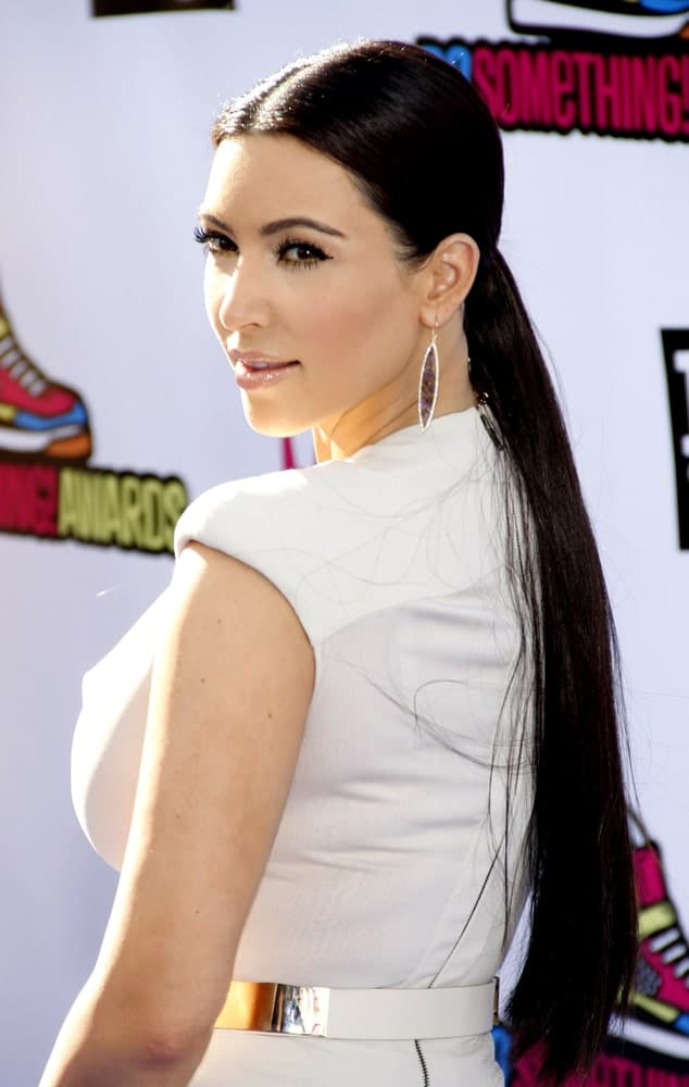 Kim Kardashian gathered her long jet black hair in a low ponytail at the 2011 VH1 Do Something Awards held at the Palladium Hollywood on August 14, 2011.