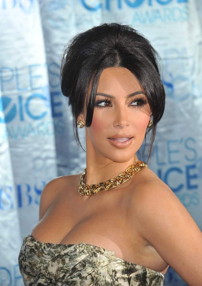 Kim Kardashian styled her raven locks with a volumized bun that's incorporated with curtain bangs and loose tendrils during the 2011 Peoples' Choice Awards at the Nokia Theatre L.A. Live in downtown Los Angeles on January 5, 2011.